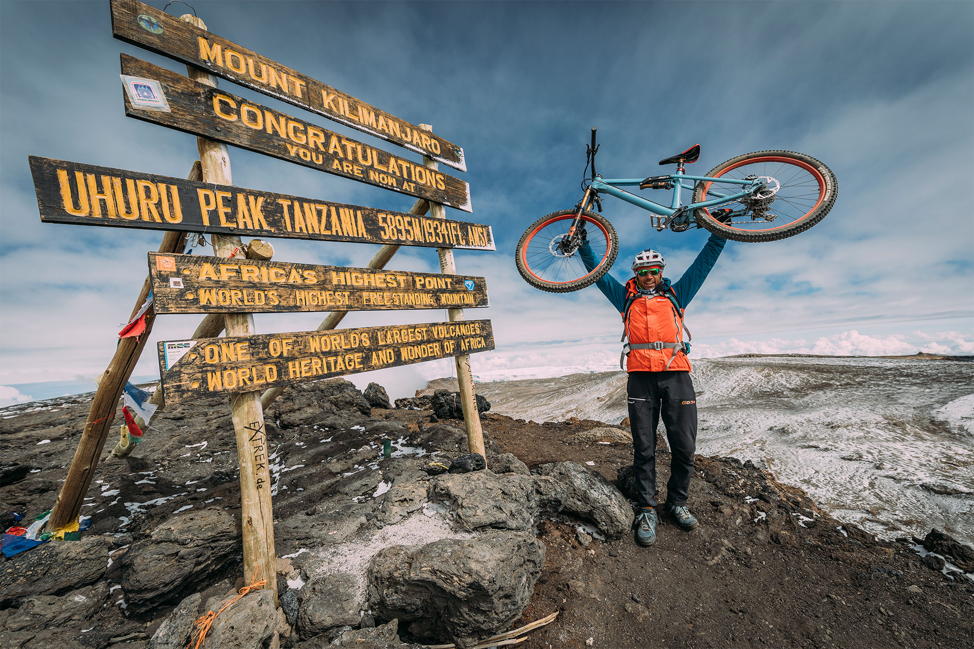 BE ONE OF THE FIRST<br>MOUNTAINBIKERS<br>ON TOP OF KILIMANJARO